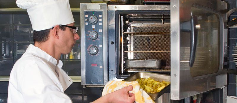 chef in commercial kitchen safety